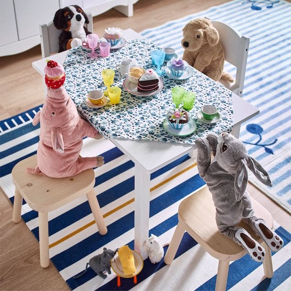A soft toys team party created by pairing IKEA SUNDVIK white table and chairs with FLISAT pine children's stools.