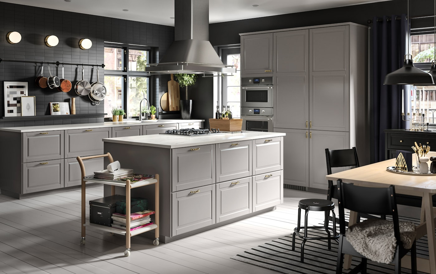 A spacious grey and white kitchen with a cooking island as the heart of the space.