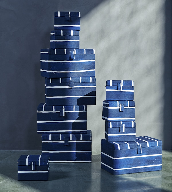 A stack of blue-and-white striped storage boxes.