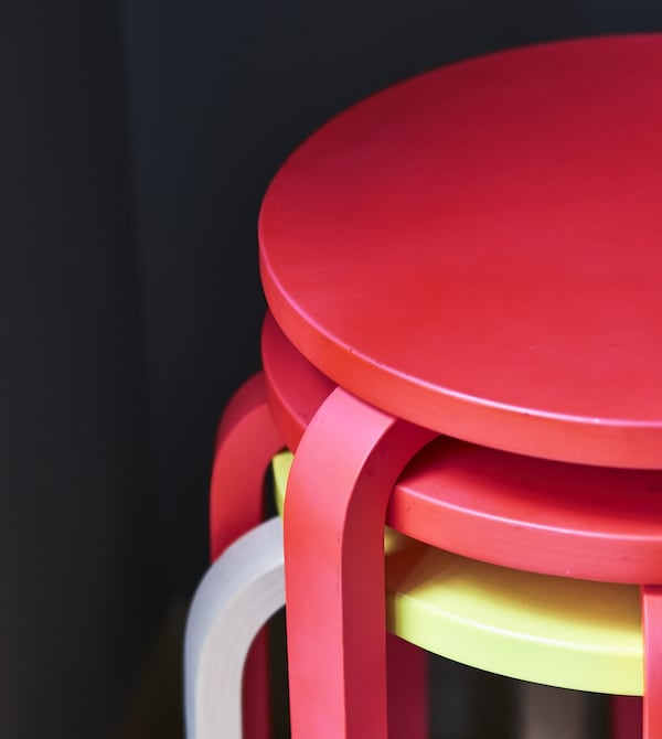 A stack of colourful stools.