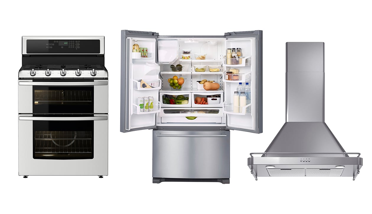 A stainless steel oven, fridge and exhaust fan