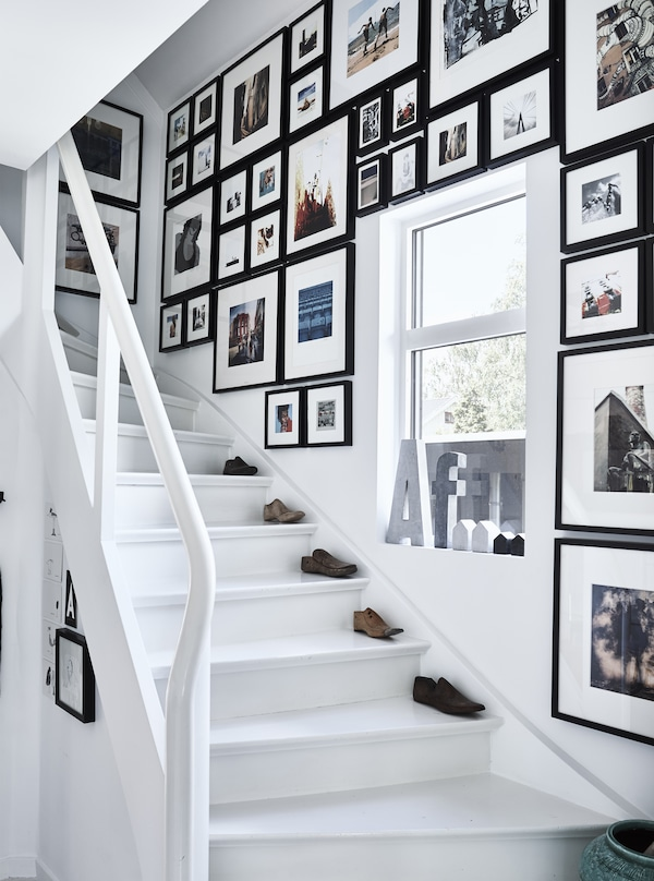 A stairwell with pictures filling the walls.