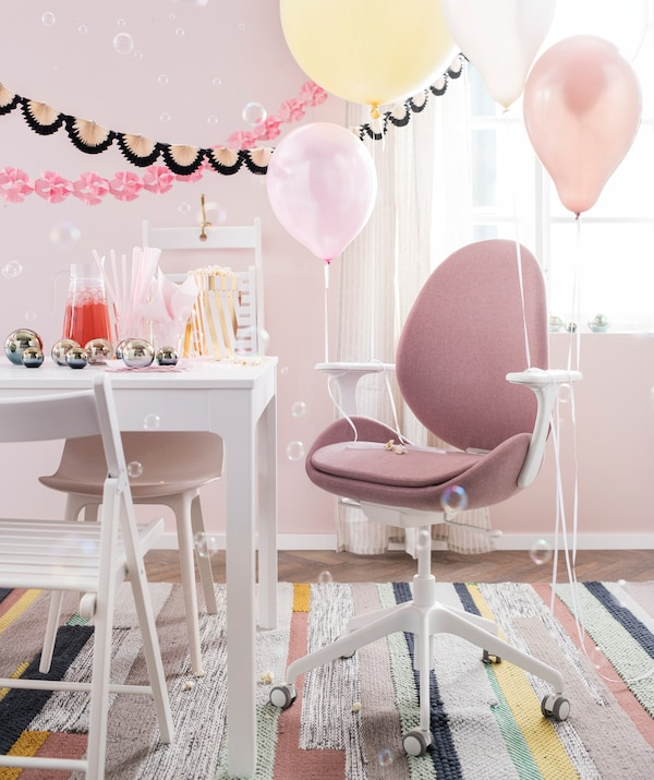 A swivel chair like IKEA HATTEFJÄLL can actually make a great thrown for the birthday kid. The adjustable height is perfect for little ones; just tie some balloons to the arms and get ready for cake.