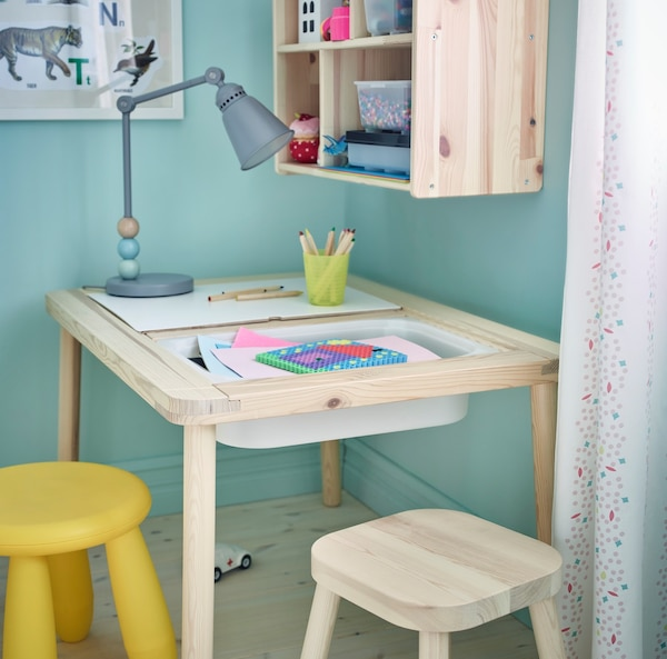 A table and two stools for kids.