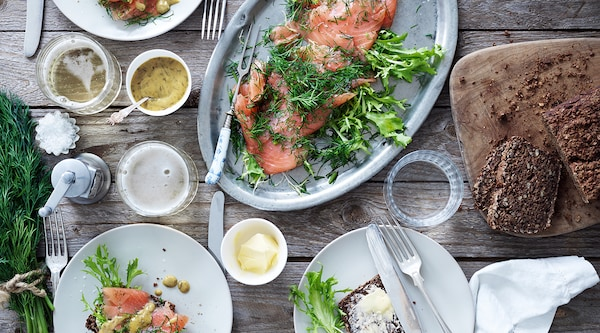 A table featuring IKEA salmon on a platter being shared.