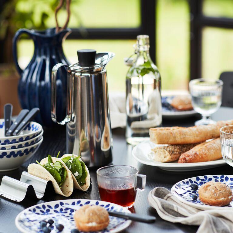 A table set for brunch with SMÅKALLT serving stand and MEDLEM tableware.