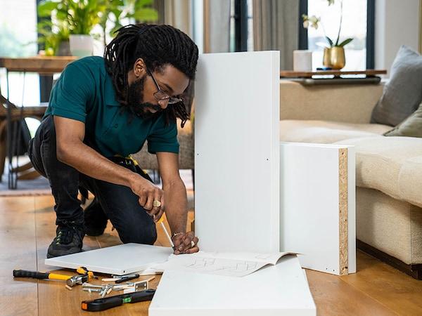 A TaskRabbit tasker assembling IKEA furniture