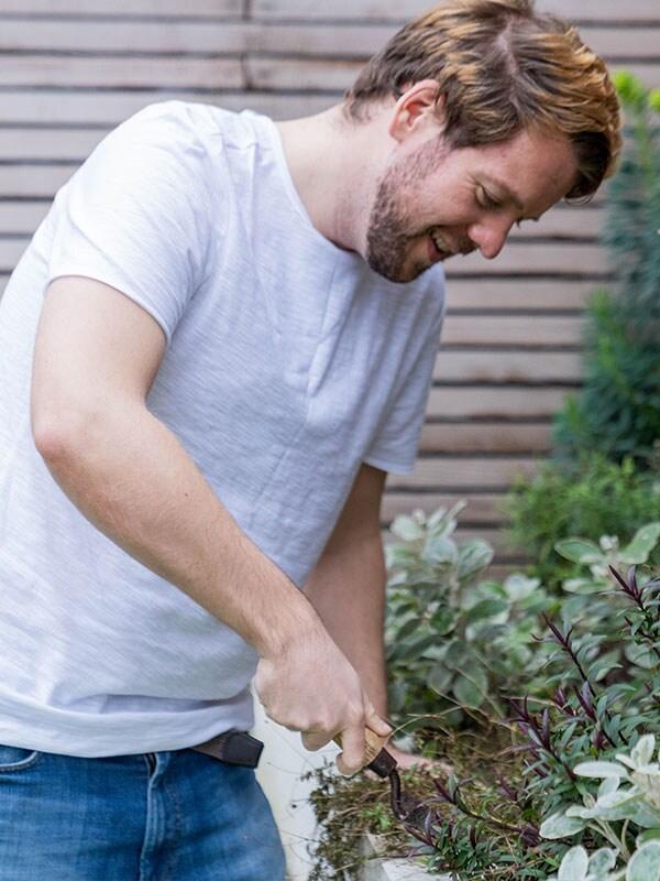 A TaskRabbit Tasker doing some garden work.