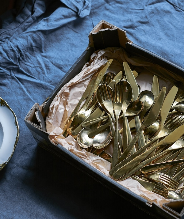 A tray of gold-colored cutlery.