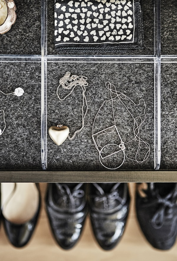 A tray with accessories and shoes.