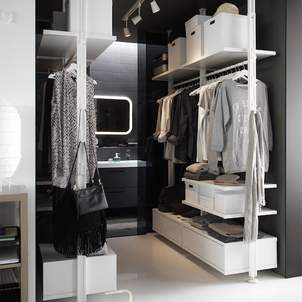A walk in closet created with the IKEA ELVARLI storage system.