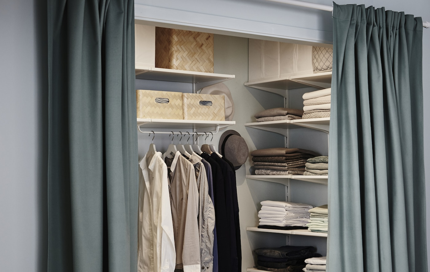 A walk-in closet gets the full treatment with lots of adjustable storage, some fresh paint and a curtain to close it off from the bedroom.