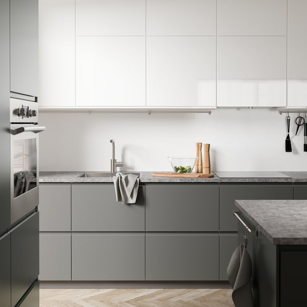 A white and grey VOXTORP and RINGHULT kitchen