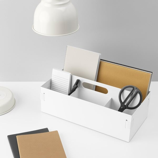 A white desk organizer.
