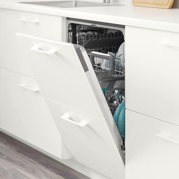 A white dish-washer with the door open, lots of dishes inside.