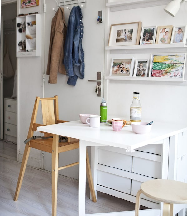 A white foldable IKEA dining table set for a snack.