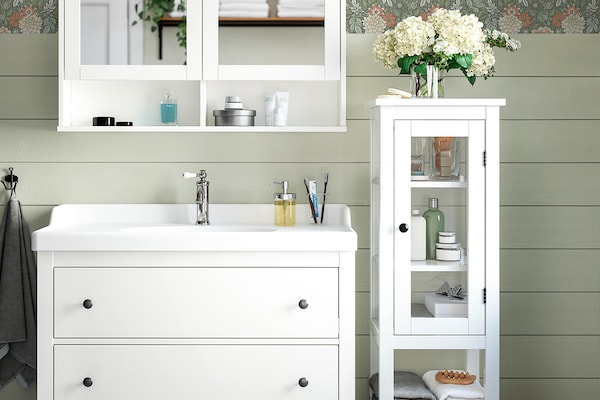 A white HEMNES vanity with a tall white cabinet.