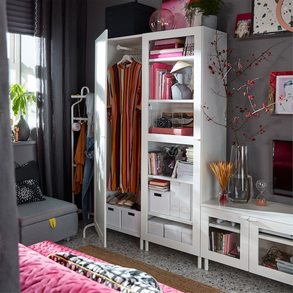 A white IKEA PLATSA media storage combination with closed doors, glass doors, and a TV-bench for a flexible storage solution.