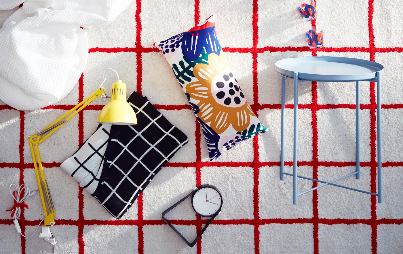 A white IKEA SIMESTED rug with a bright red square pattern and high pile is the backdrop for a product collage.
