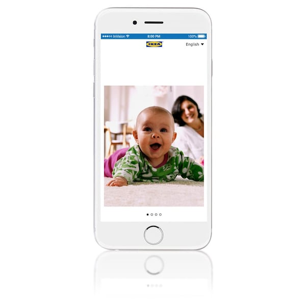 A white iphone with an image of a baby on it against a white background.