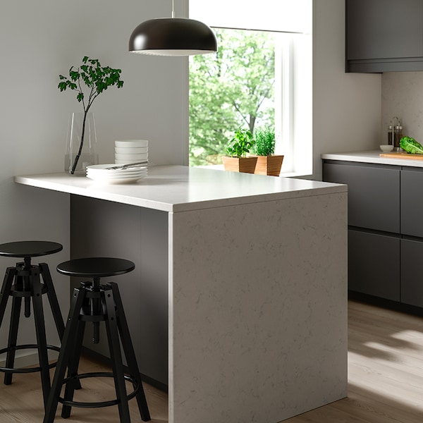 A white KASKER custom countertop in a small kitchen