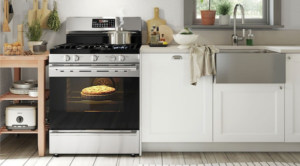 A white kitchen featuring stainless steel appliances