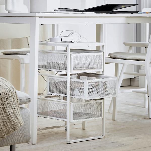 A white LENNART drawer unit under a white desk.