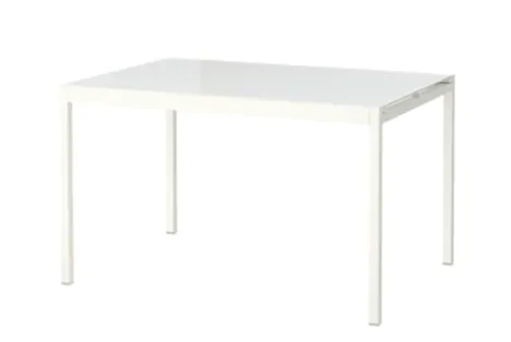 A white rectangular dining table against a white backdrop