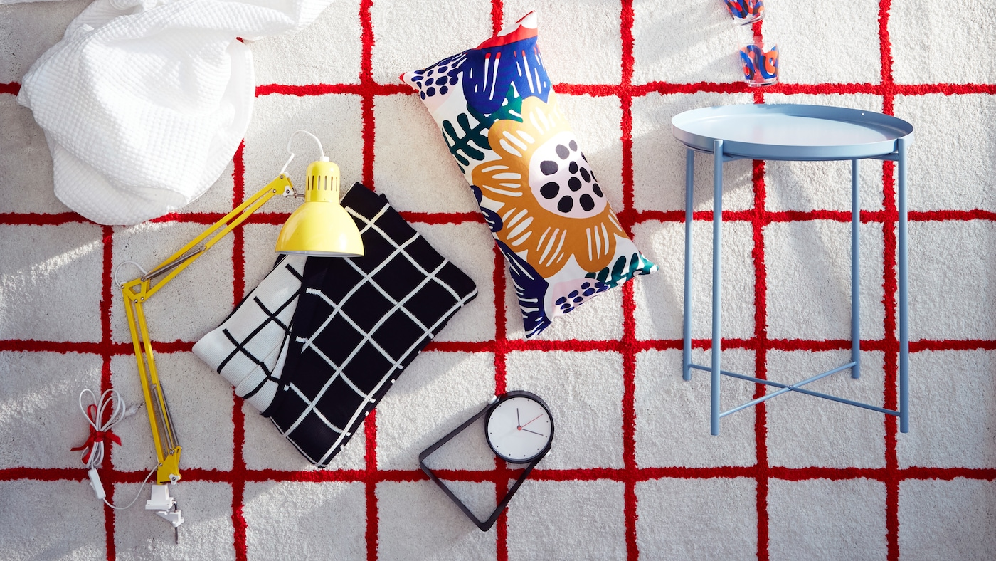 A white SIMESTED rug with a bright red square pattern and high pile is the backdrop for a product collage.