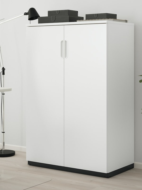 A white storage unit for an office