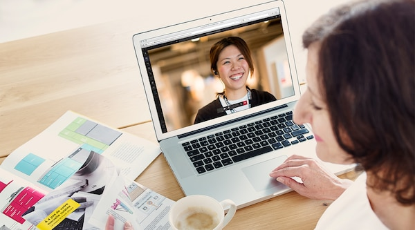 A woman having a video kitchen planning session with an IKEA kitchen planner.
