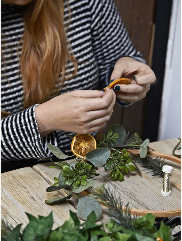 A woman sitting at a table crafting.
