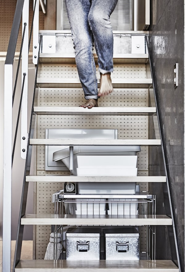 A woman walking down stairs.
