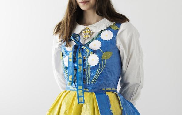 A woman wearing a dress made from IKEA FRAKTA bags.