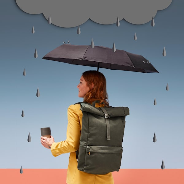 A woman with a green backpack, holding an umbrella amidst stylized raindrops.