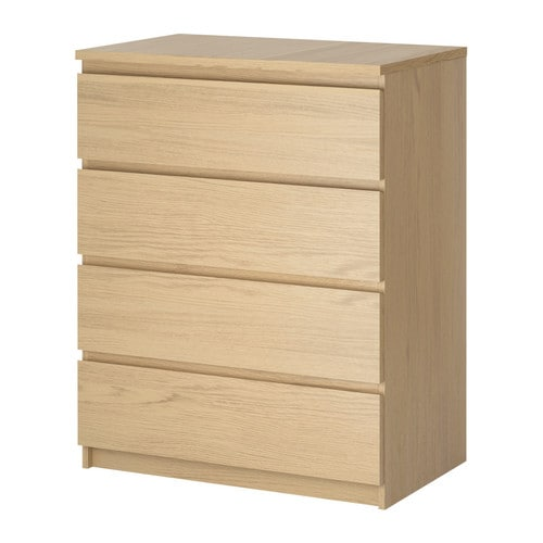 A wood colored drawer chest against a white background.