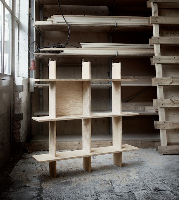 A wooden shelving unit in a workshop.