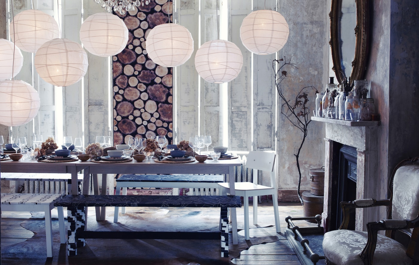 A woodland-style dining room with snowy lanterns and a table covered in winter decoration