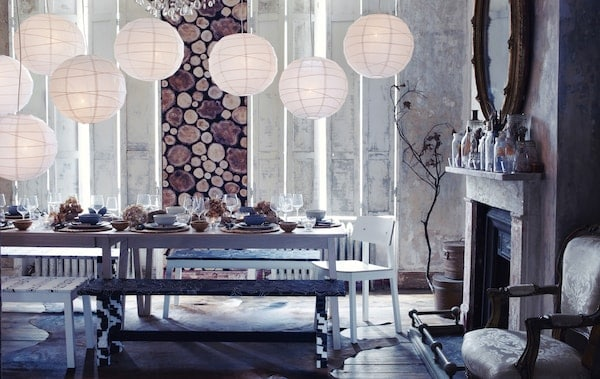 A woodland-style dining room with snowy lanterns and a table covered in seasonal decoration