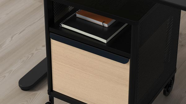 A black BEKANT drawer unit with birch front