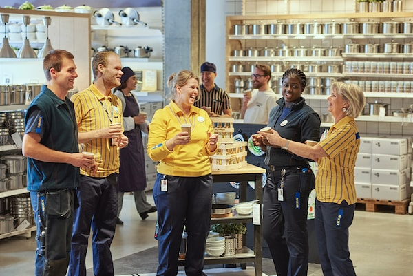 A group of IKEA coworkers talking to each other