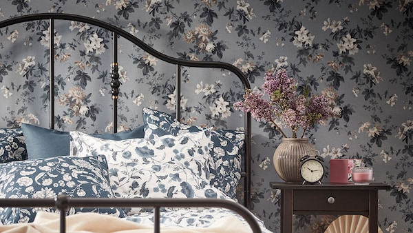 SAGSTUA bed frame with floral bedding linking to the bedrooms page.