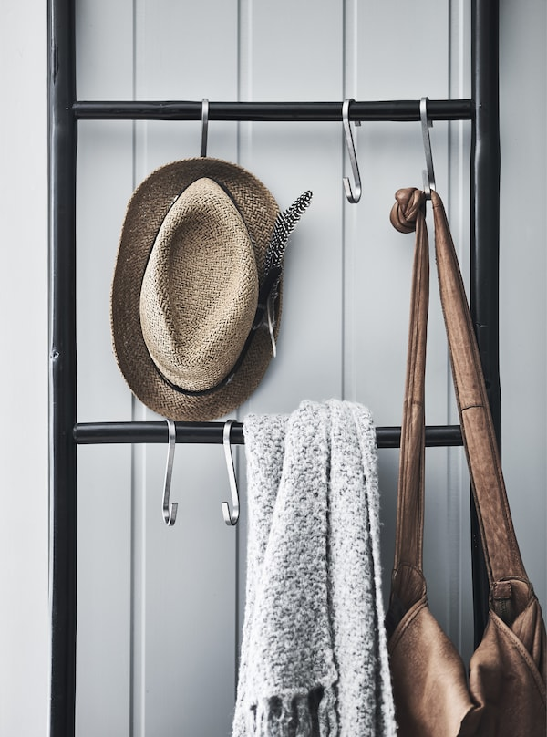 Accessories hanging on hooks on a ladder.