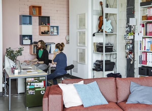 Adam and Deborah working in their home office.