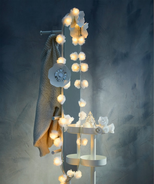 Add more holiday magic by framing a mirror with IKEA LIVSÅR LED lighting chain.