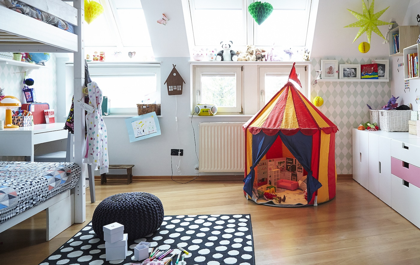Adding a rug to a kid's bedroom creates a comfy space to play.