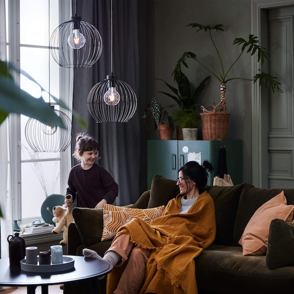 Adult and child on a sofa in a cozy modern living room