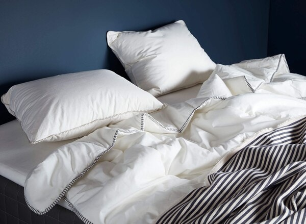 Bed with pillows and comforter