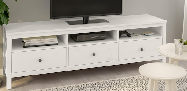 White three drawer media stand with open storage areas above the drawers