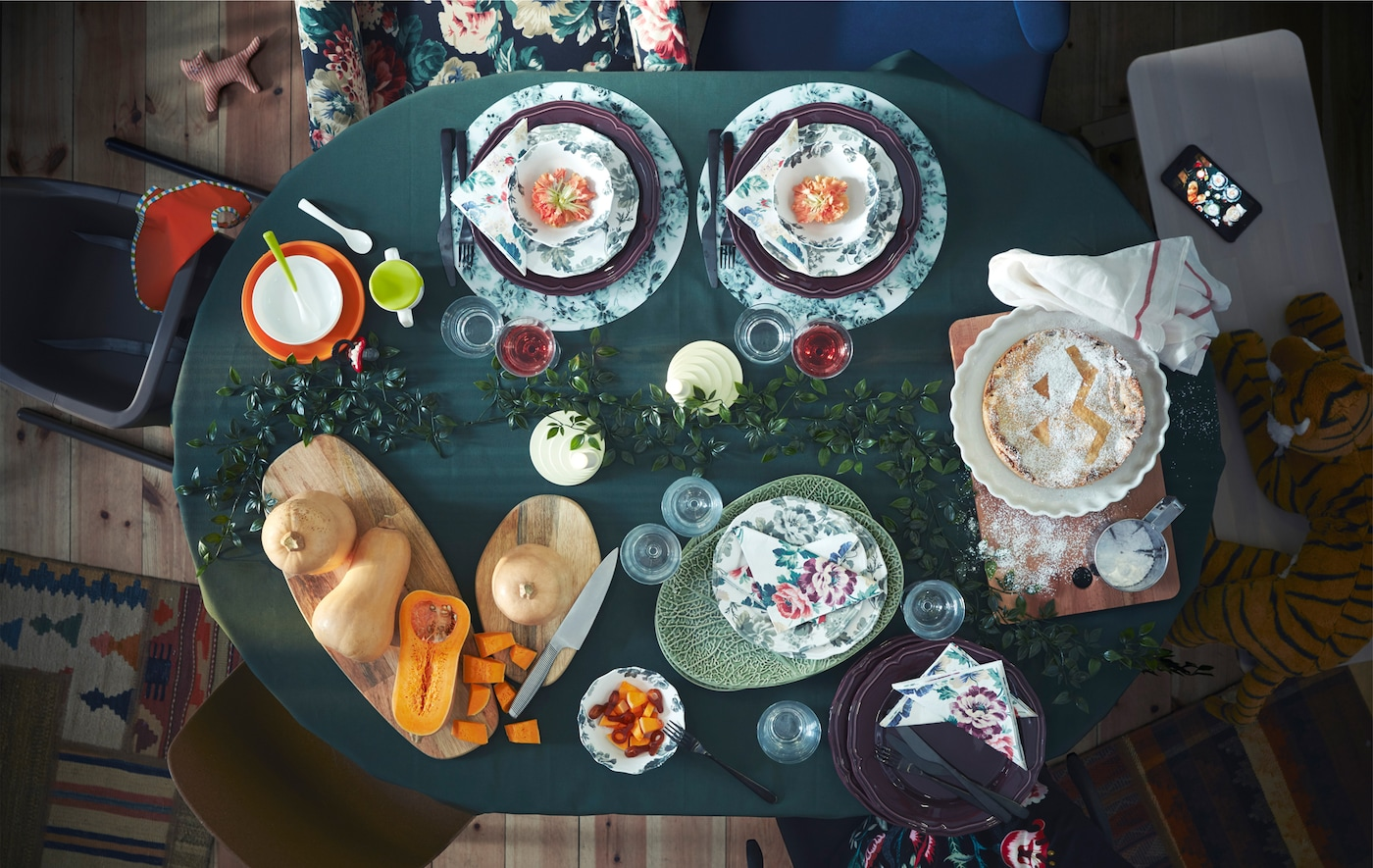 Aerial image of an IKEA INGATORP dining table covered in plates, cutlery and food.